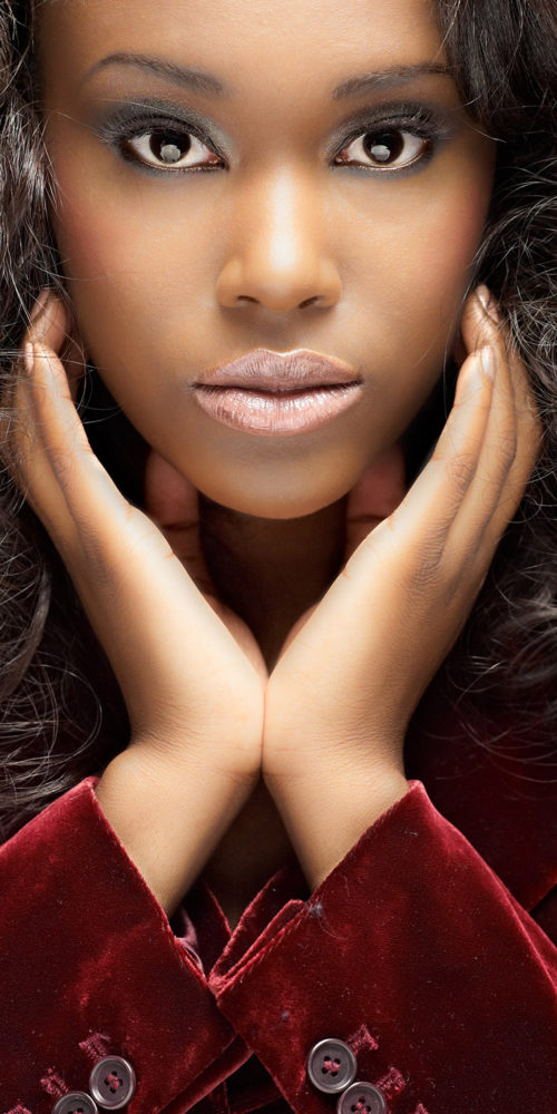 makeup for beauty editorial - close up of woman's face and hands