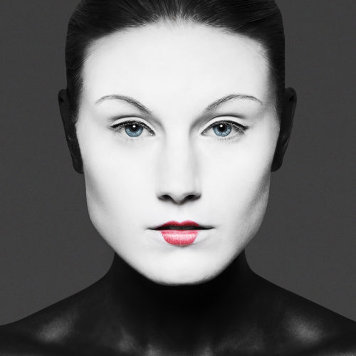 makeup for beauty fashion editorial - woman with white face and red lipstick