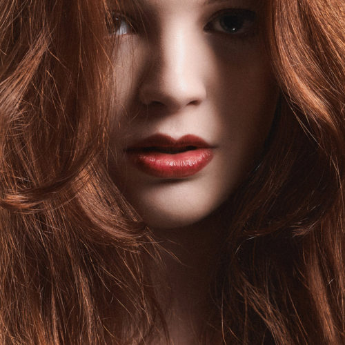 makeup for beauty editorial - red haired woman with red lipstick