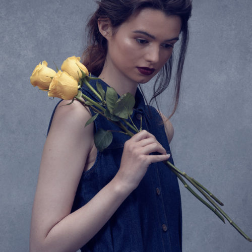 Makeup for fashion shoot - model in blue dress with yellow tulips