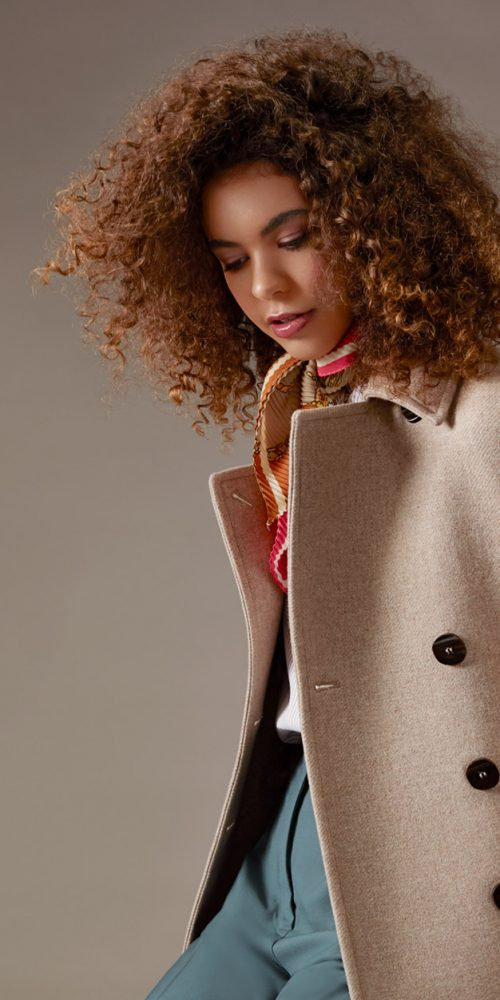 Fashion makeup - model in cream overcoat
