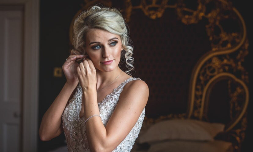 Bridal makeup shoot - bride adjusting an earring
