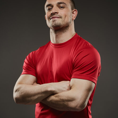Male styling - model in tight red t-shirt
