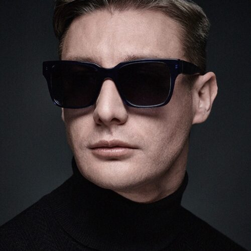Male styling - model dark jumper and sunglasses