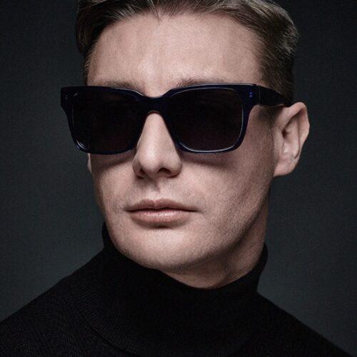 Male styling - model dark jumper and sunglasses
